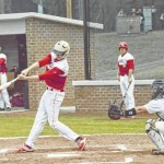Cards hang on for opening day win