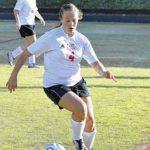 Lowe's hat trick lifts Lady Cards