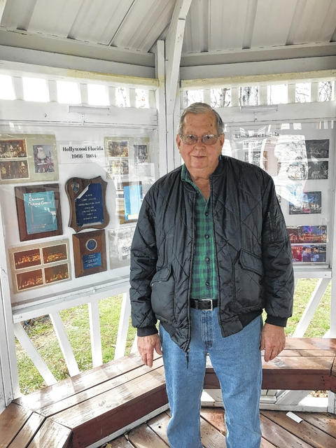 larry charpiat stand in a gazebo he built to display the awards won and showcase photos from previous years at pilot mountain christmas lights