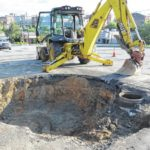 Sinkhole surfaces in street