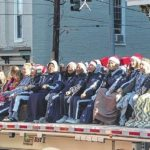 City holiday parade to roll Saturday