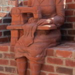 Statues spruce up downtown wall
