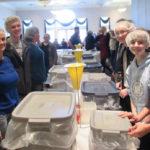 77 volunteers pack 10,000 meals