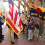 Scouts place time capsule downtown