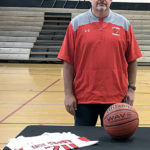 Cardinals name new hoops coach