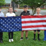 Student donates flags to Dobson school
