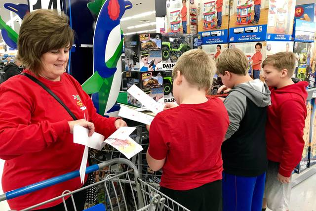 some young volunteers help buy gifts for sheriff atkinsons give a kid a christmas at walmart last december submitted photo