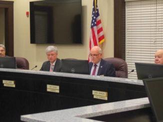County debates employee conflicts