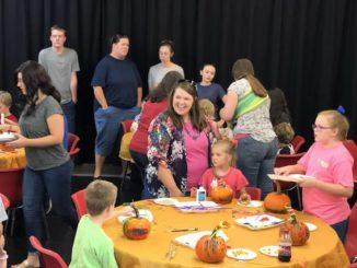 Kids enjoy pumpkin decorating workshop