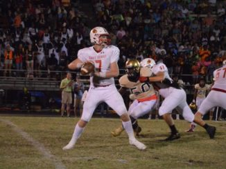Cardinals Cruise to Win in Conference Debut