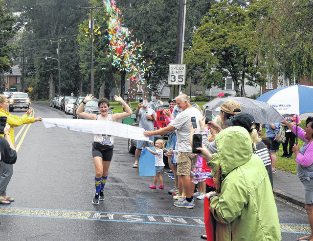Family, friends cheer marathon runner